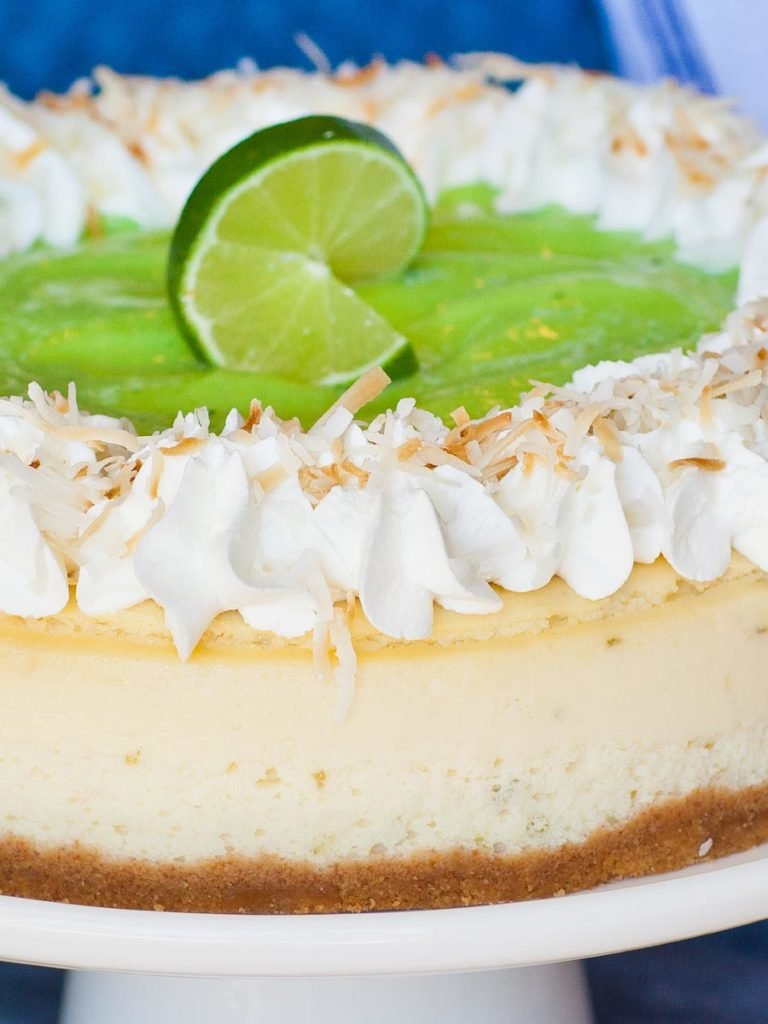 coconut cheesecake with lime curd and whipped cream