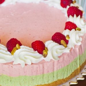 pistachio raspbery ice cream cake with whipped cream