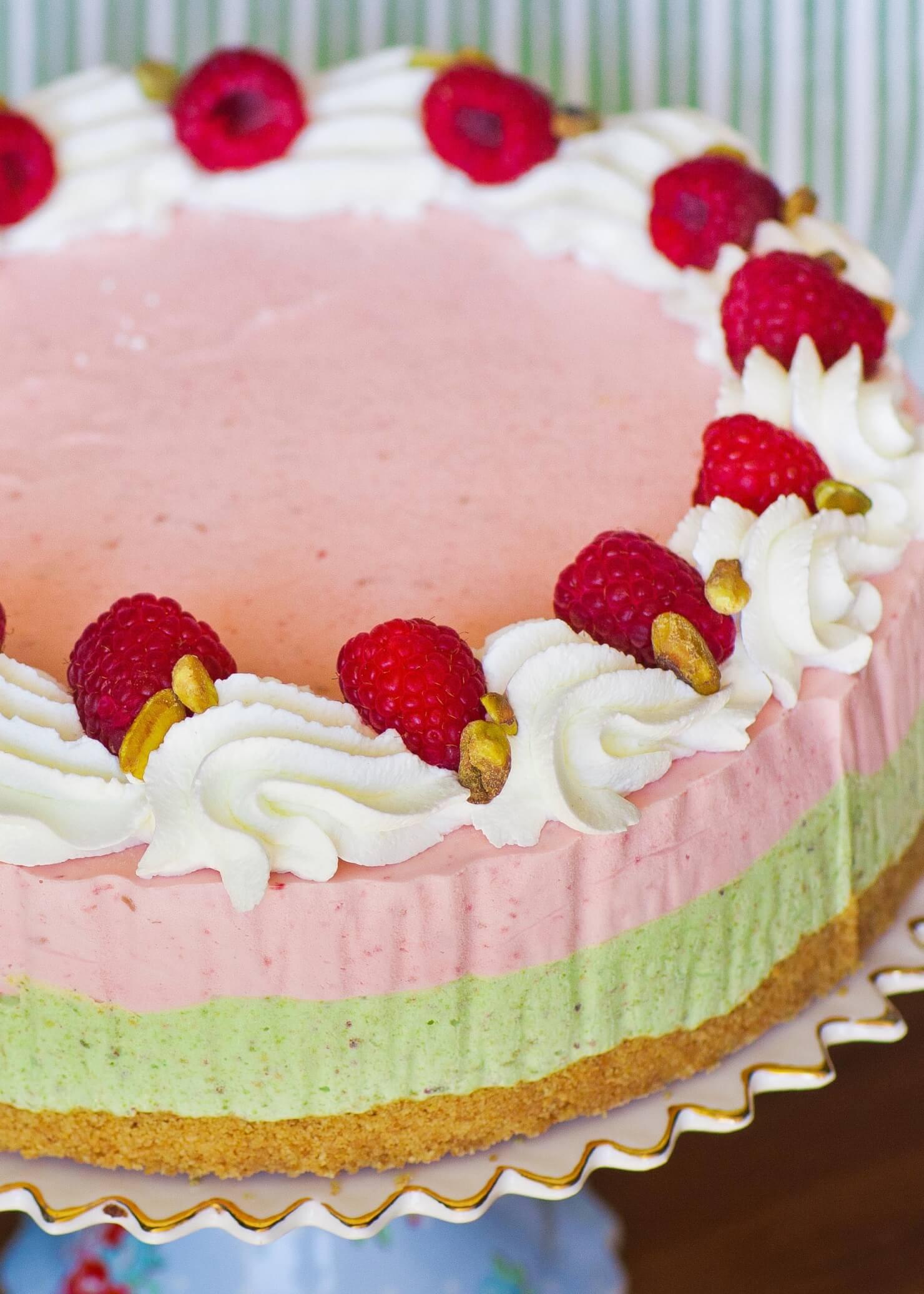 pistachio raspbery ice cream cake with whipped cream