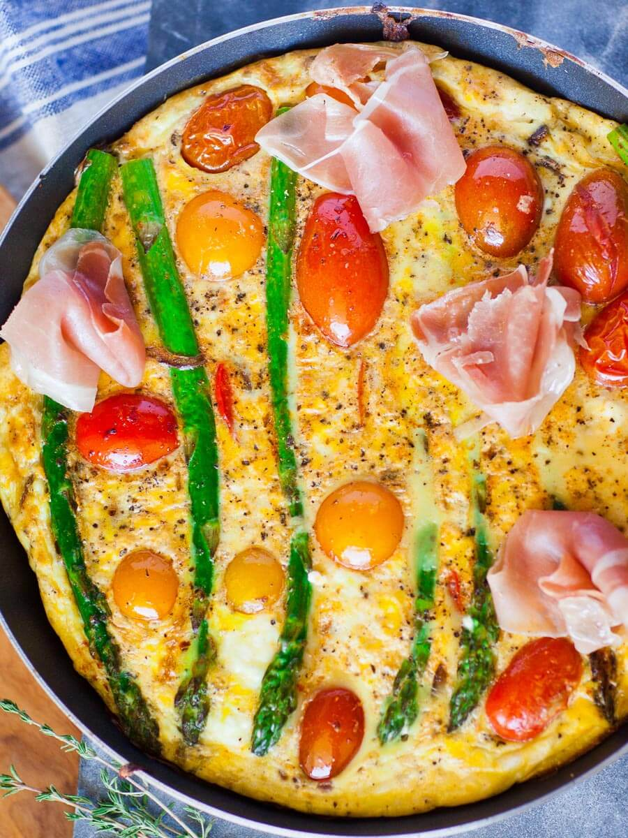 asparagus and prosciutto frittata with goat cheese and tomatoes