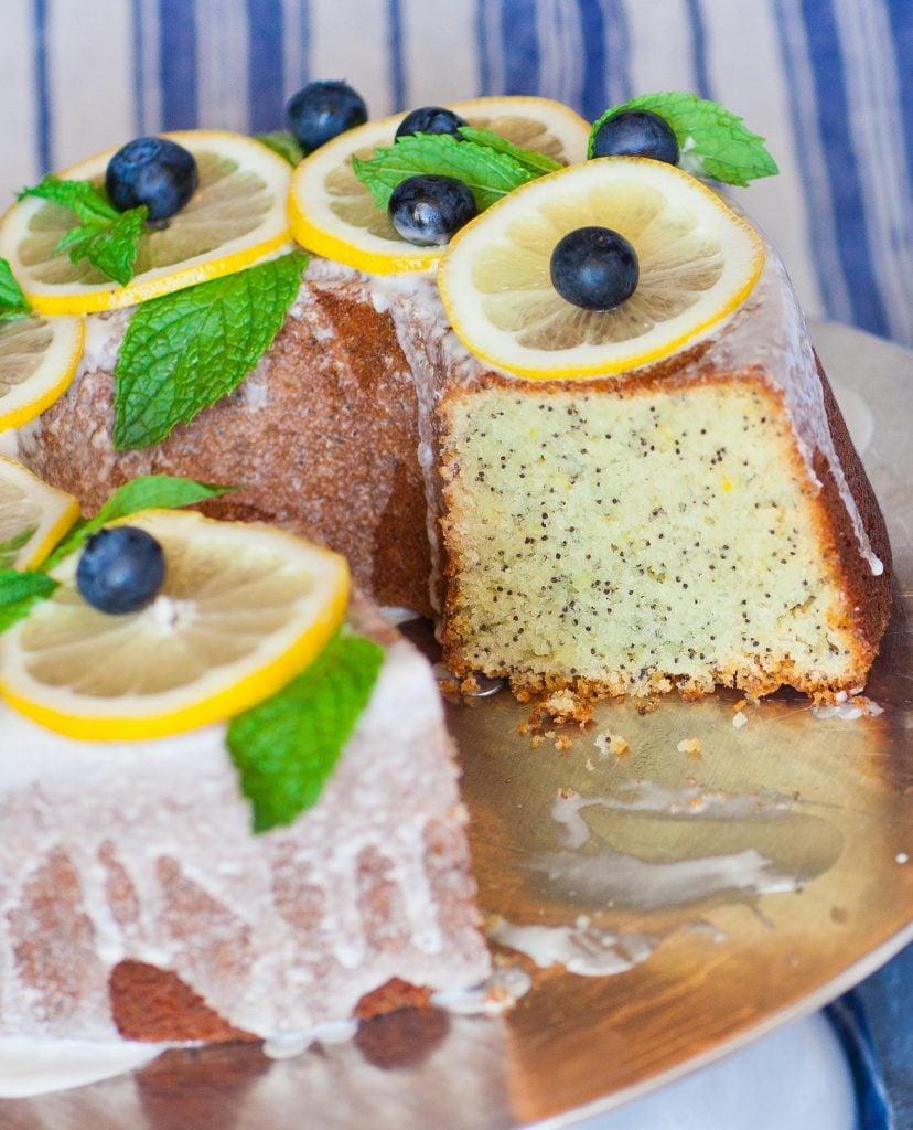 lemon poppy seed bundt cake with lemon glaze sliced