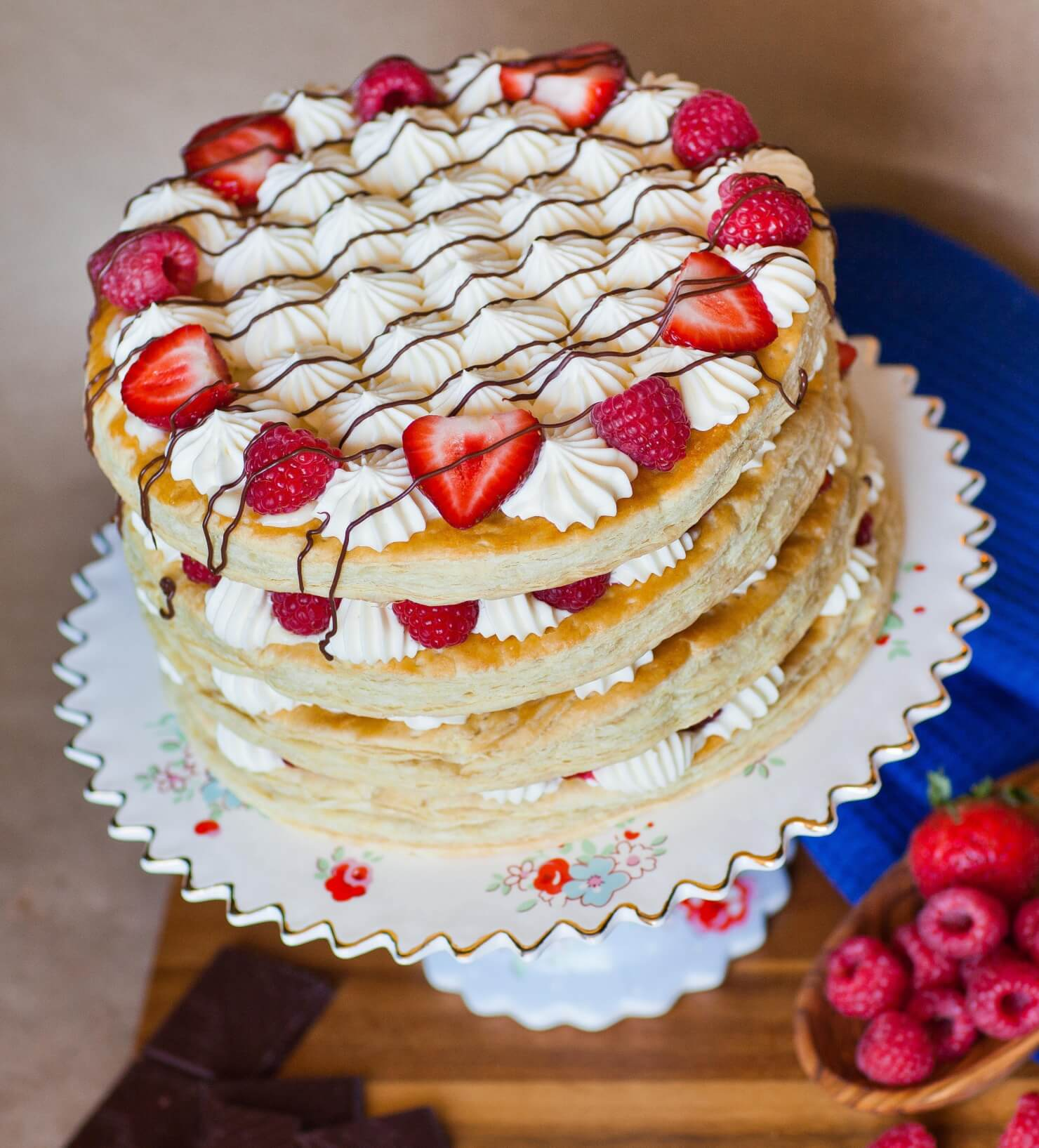 mille feuille cake wth custard filling and berries