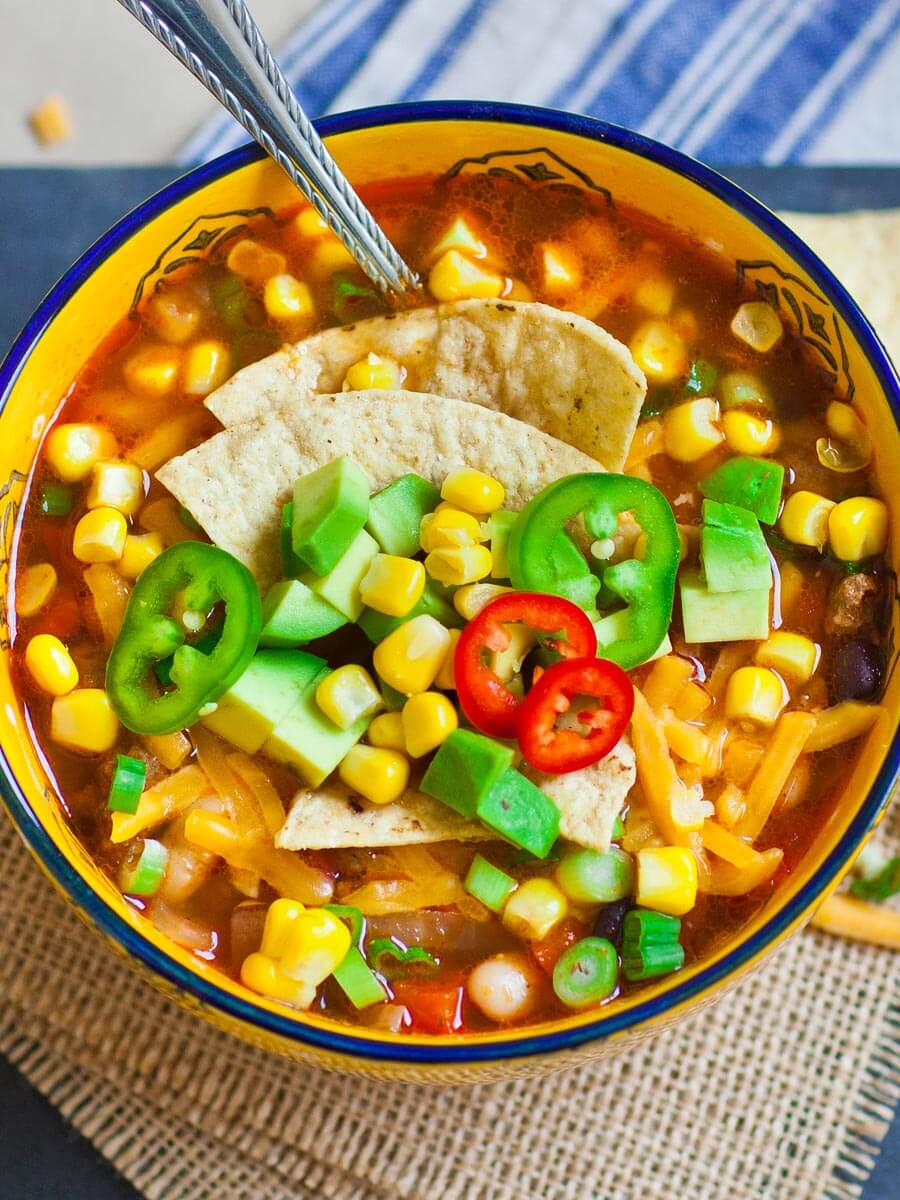3-bean chili recipe with beef, tortilla chips, avocado and corn