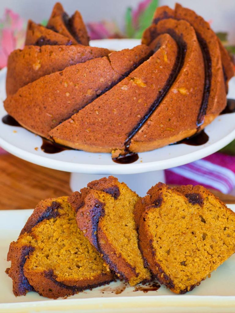 spiced pumpkin cake with maple extract and chocolate glaze