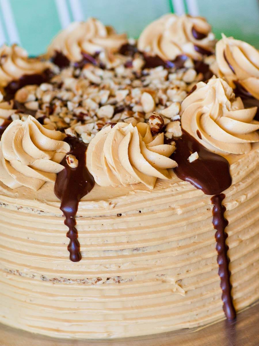 apple pie cake with salted caramel frosting, pecans and chocolate ganache