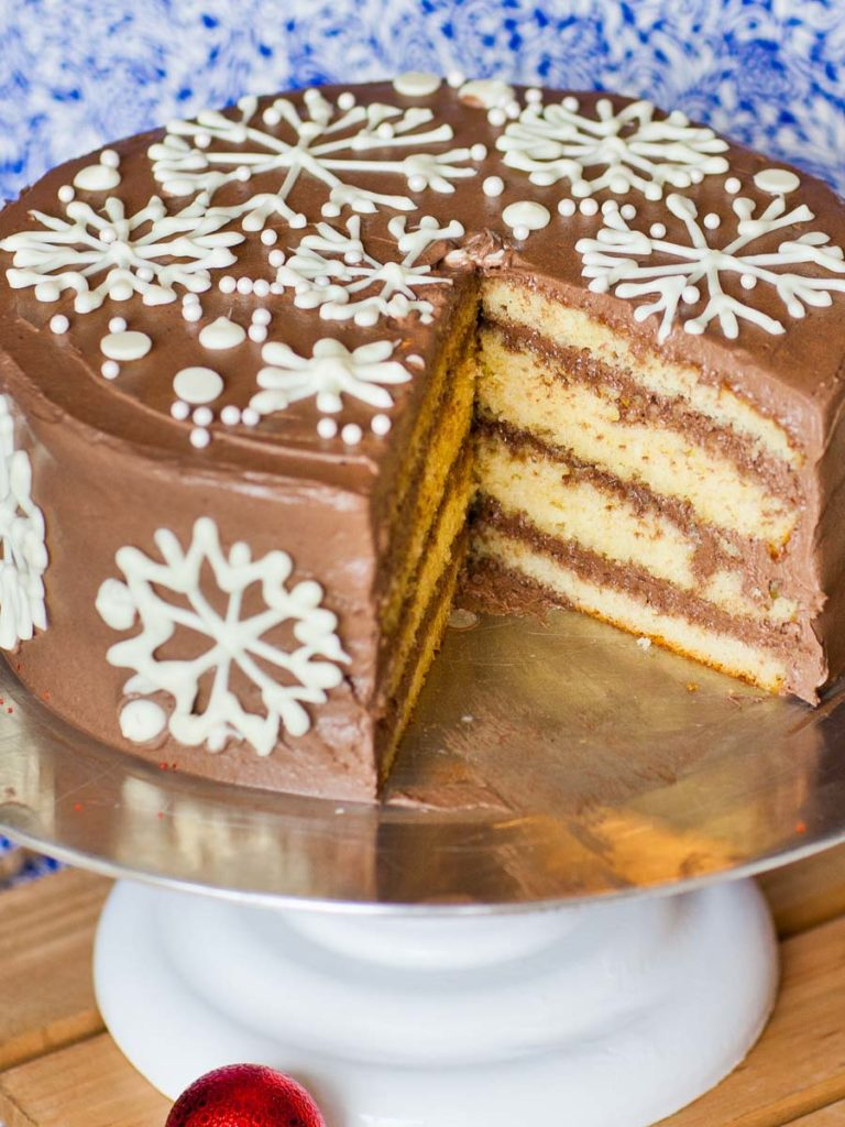 holiday eggnog cake with eggnog cake layers and chocolate buttercream