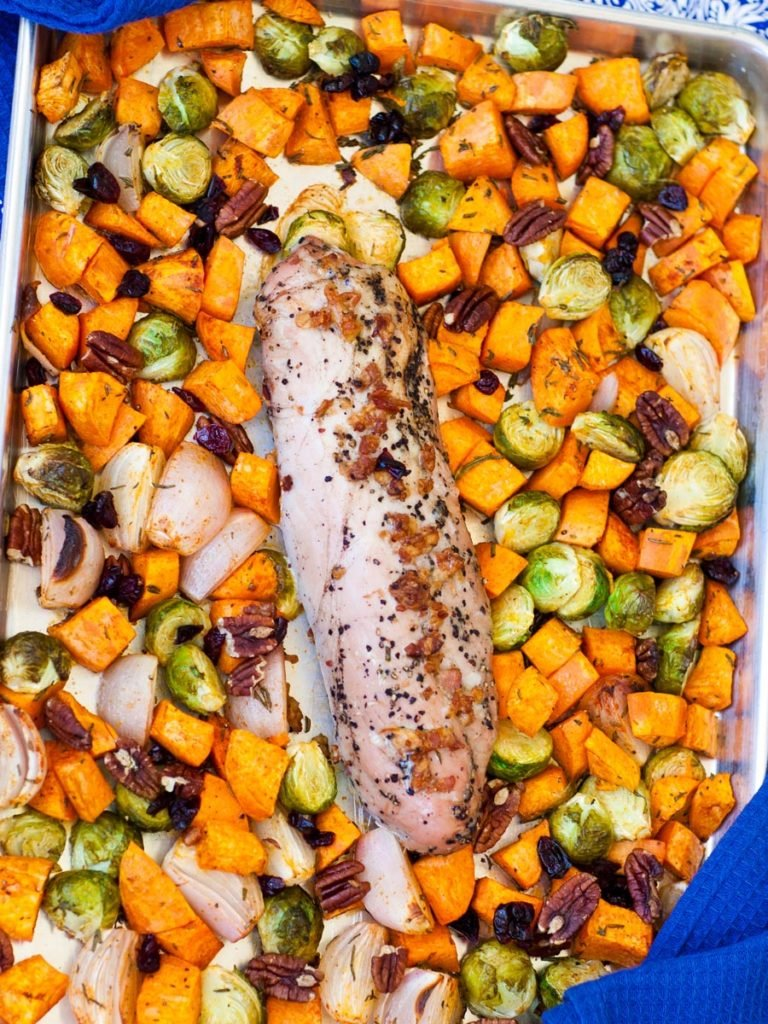 bacon pork tenderloin in pan with sweet potatoes and brussel sprouts