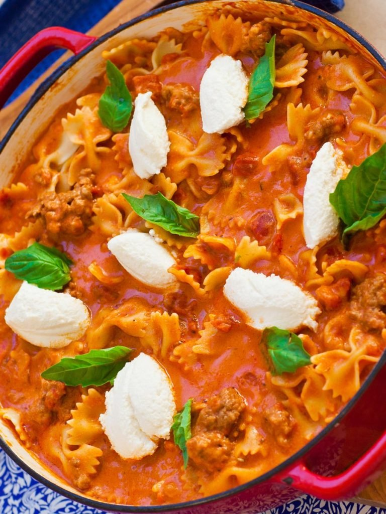 easy lasagna recipe prepared in a skillet with ricotta cheese and basil