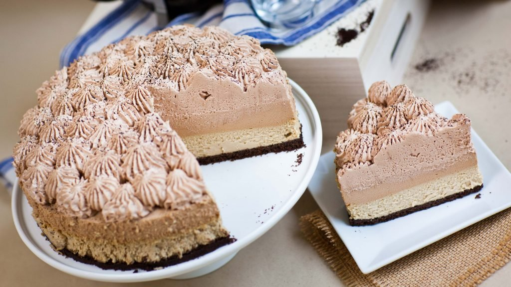 triple coffee chocolate mousse cake with slice on the side