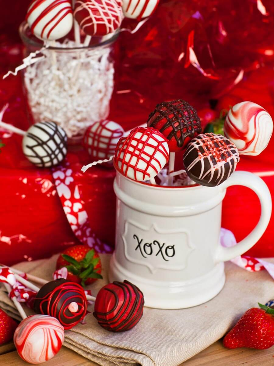 red, white and dark chocolate cake pops in coffee mug for Valentine's Day