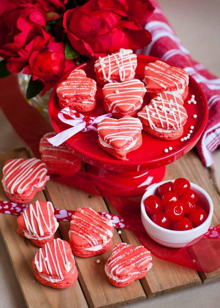 heart shaped macarons with maraschino cherries and white chocolate
