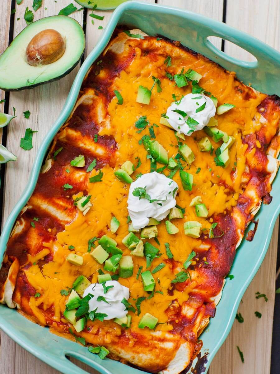 chicken enchiladas recipe with red taco sauce and cheddar cheese