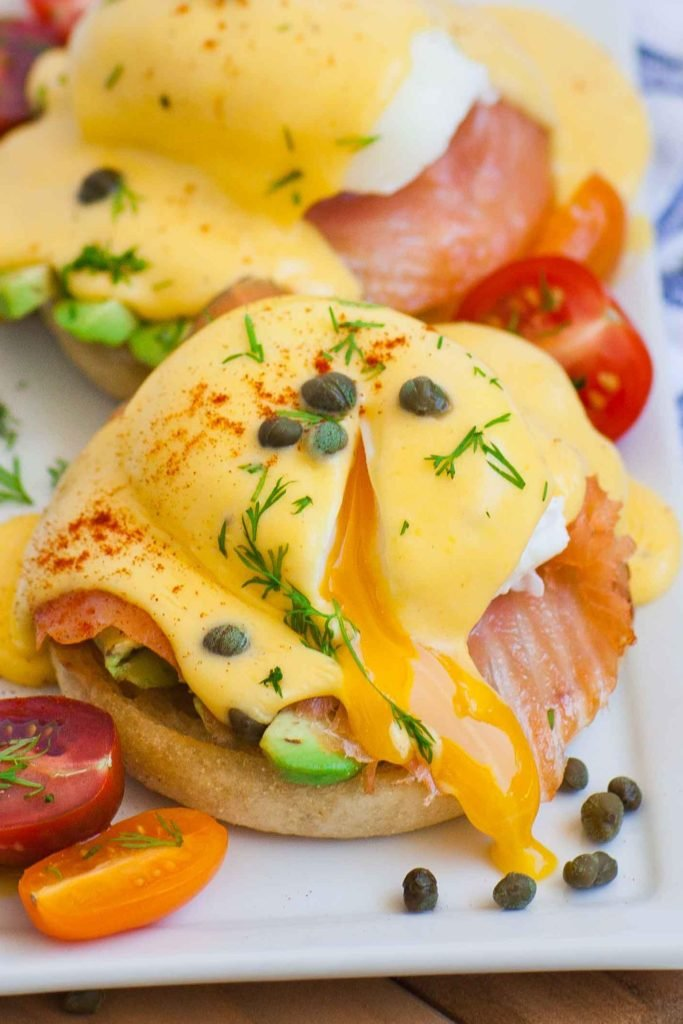 smoked salmon eggs benedict with avocado and capers