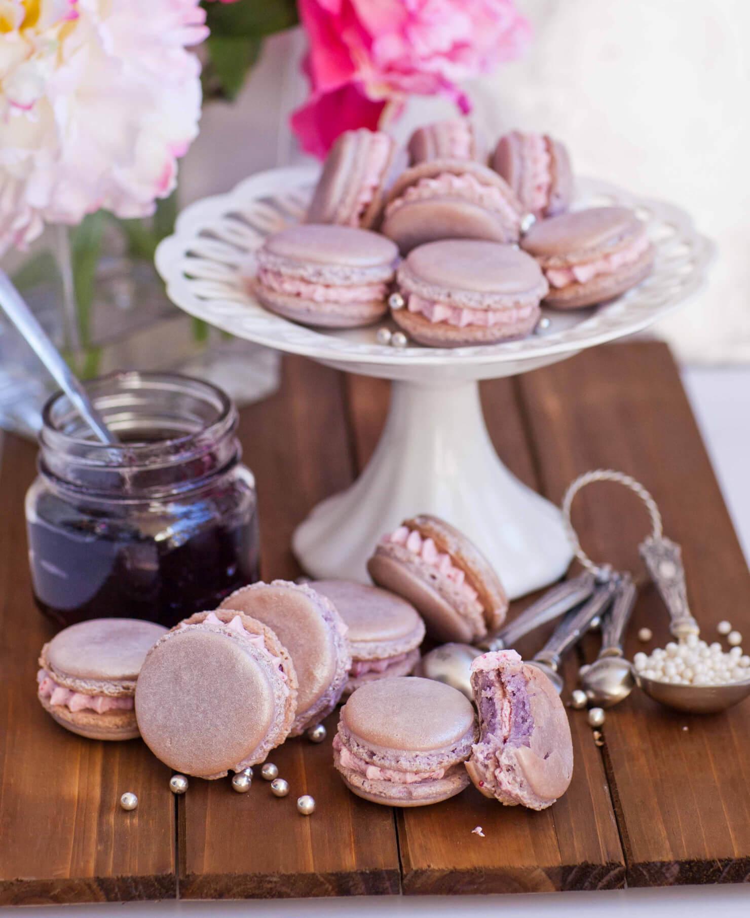 grape macarons on cake stand