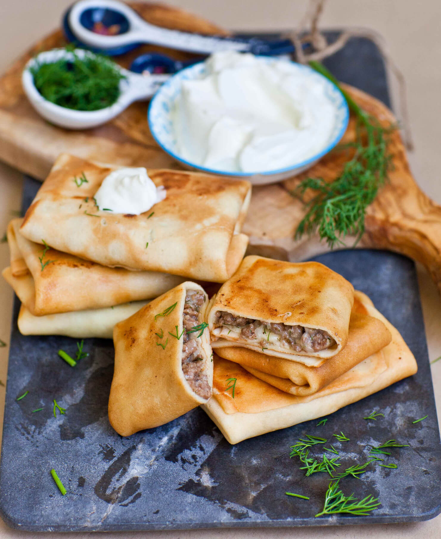 russian blini filled with meat with sour cream