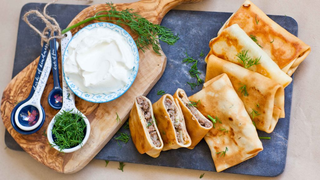 meat blini, beef filled crepes, meat pockets with sour cream