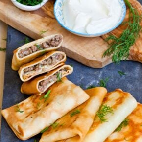 meat and cheese blini with dill and sour cream