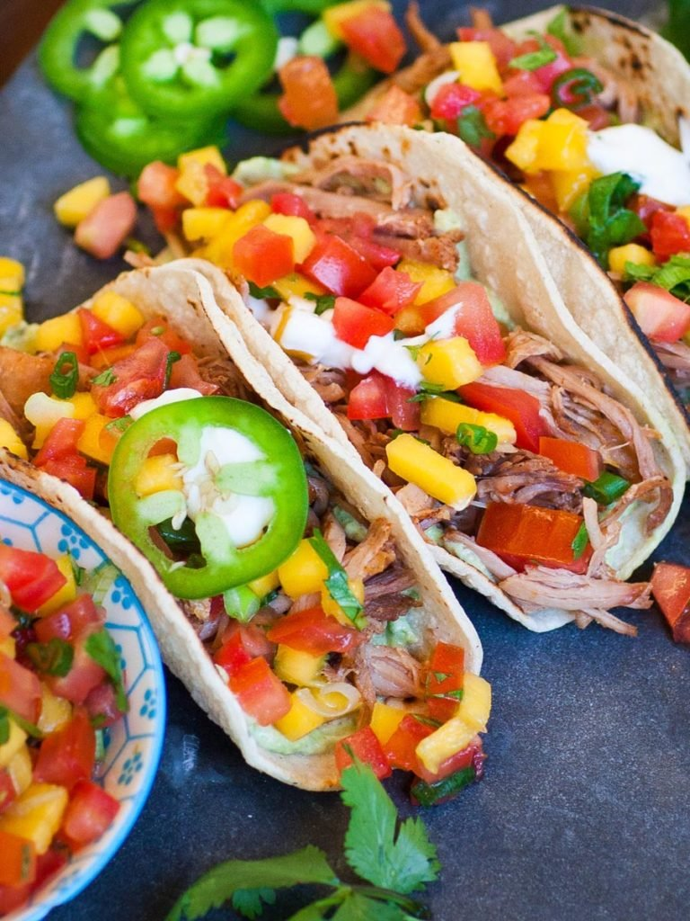 best carnitas tacos with guacamole, salsa and sour cream