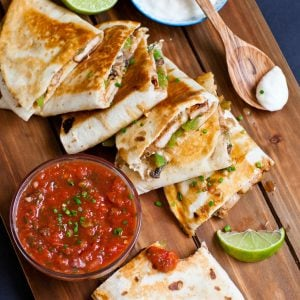 pork and pepper quesadillas with salsa and limes