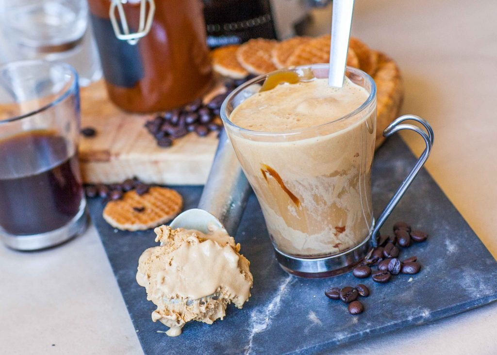 affogato italian coffee dessert with ice cream, coffee beans and waffles