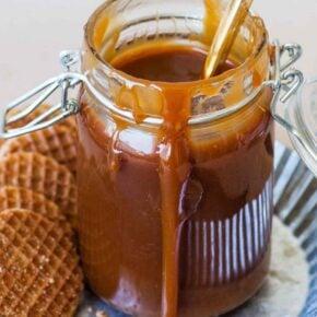 homemade salted caramel sauce in glass jar