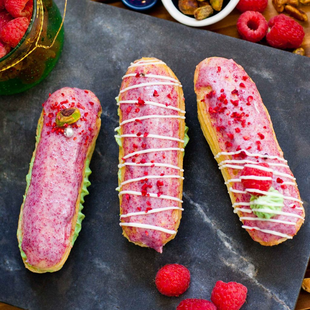 raspberry eclairs with pistachio eclair filling