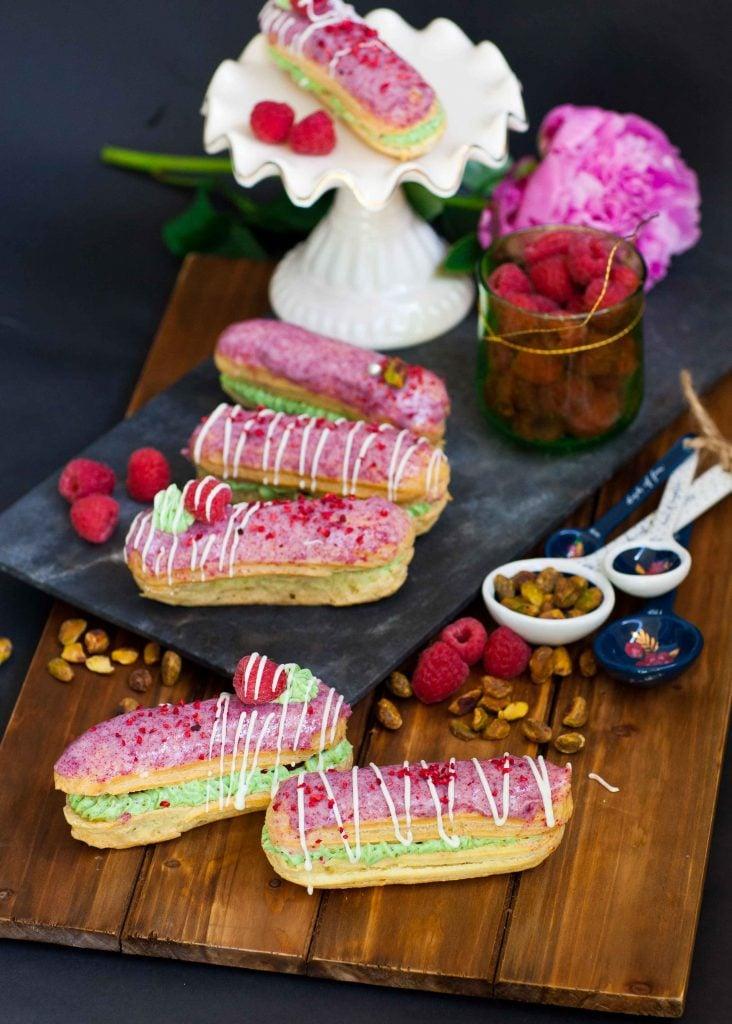 raspberry pistachio eclairs with raspberry glaze and fresh raspberries