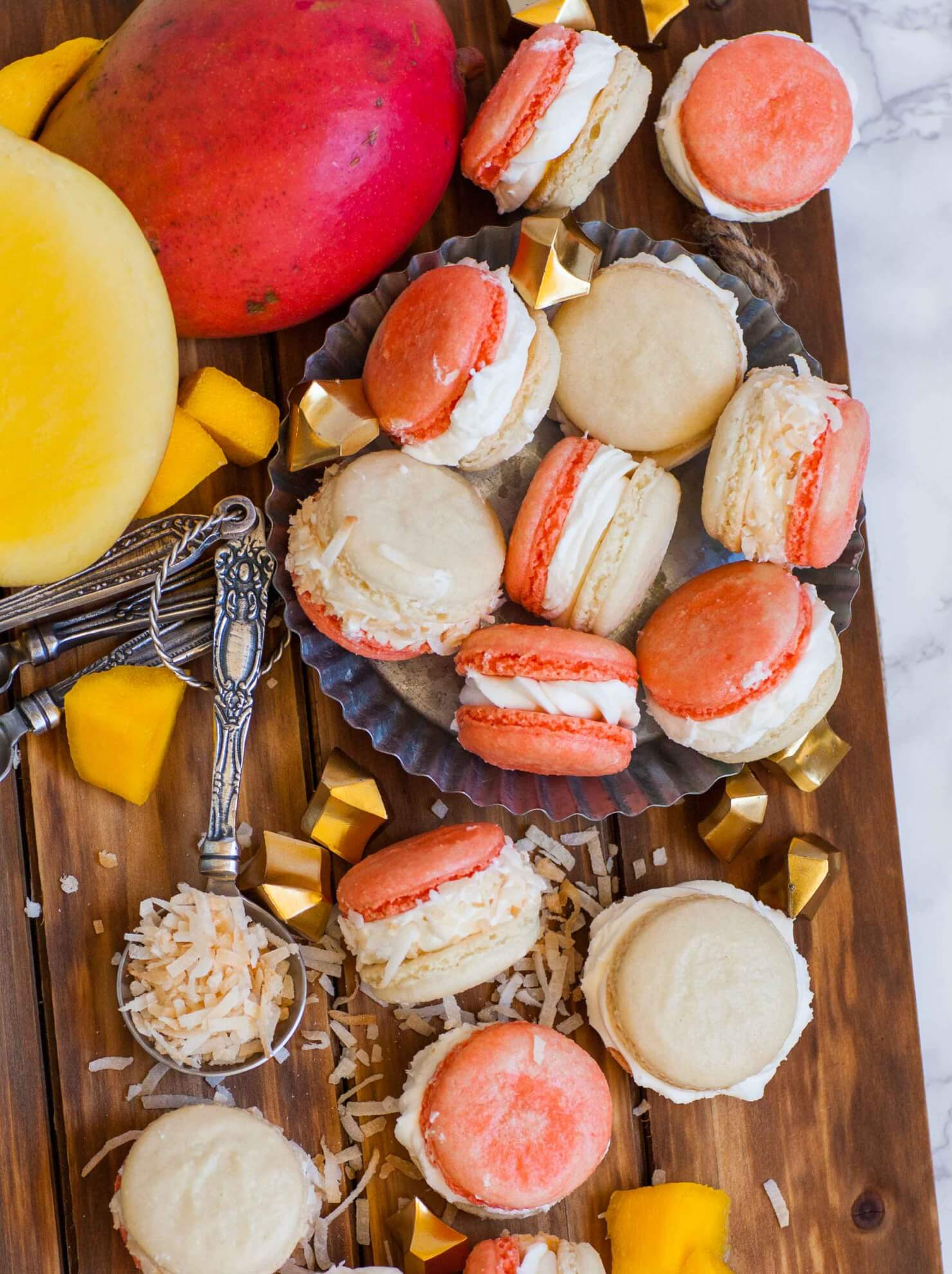 coconut mango macarons with coconut flakes and mango chunks