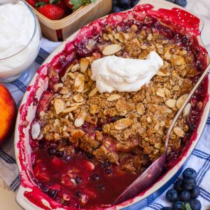 mixed berry crumble with cream