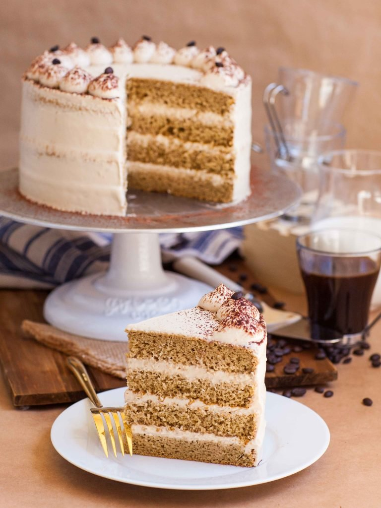 slice of tres leches cake with coffee