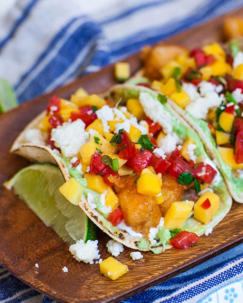 fish tacos with mango salsa and cheese