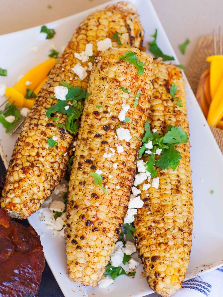 seasoned grilled corn with cheese and cilantro