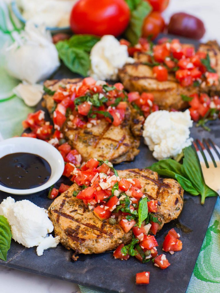 grilled pork with italian bruschetta and cheese