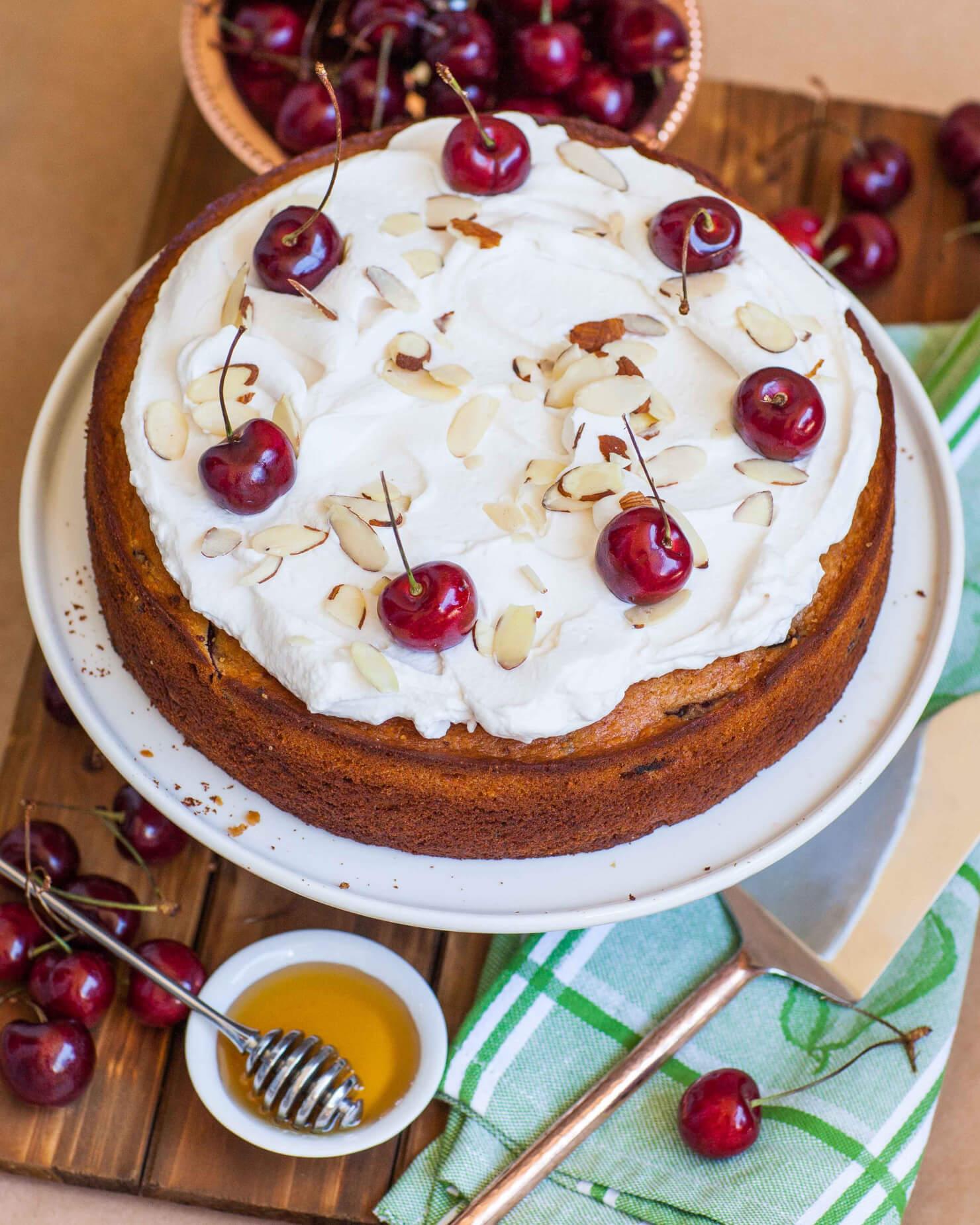 honey cake with cherries and cream