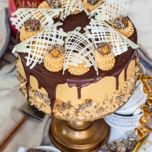 caramel cake with chocolate ganache and chocolate garnishes