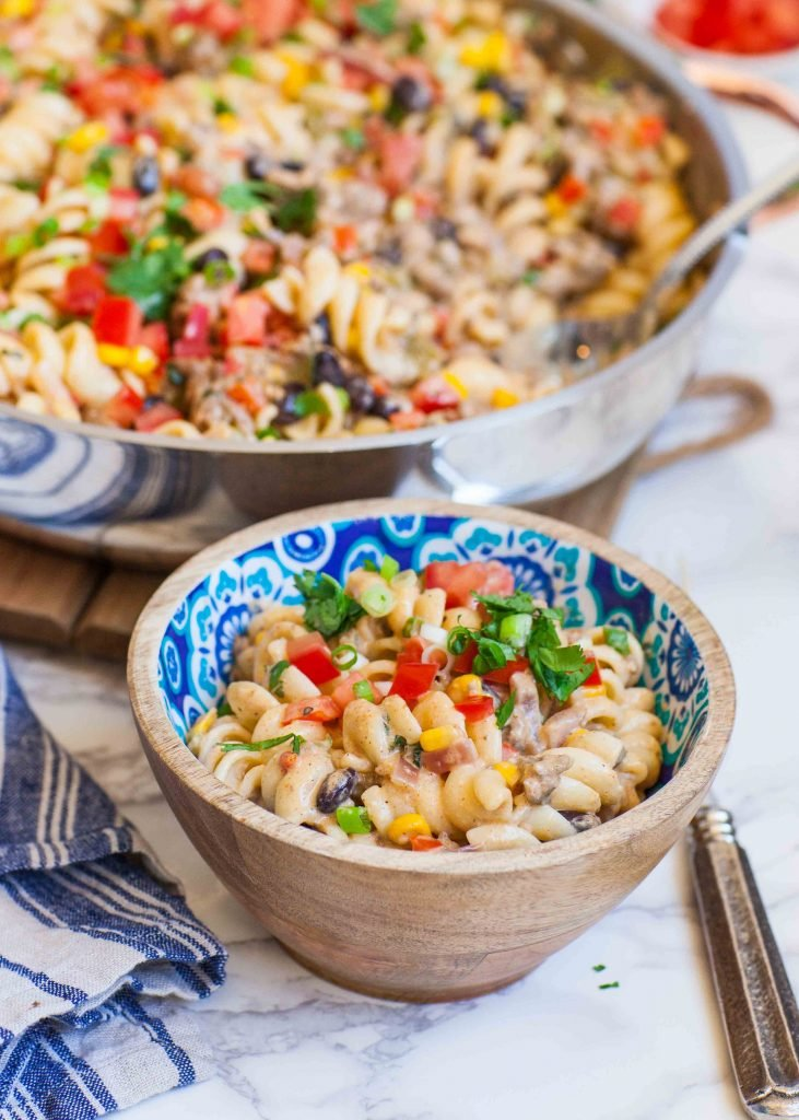 cheesy taco pasta recipe with ground beef, corn and tomatoes