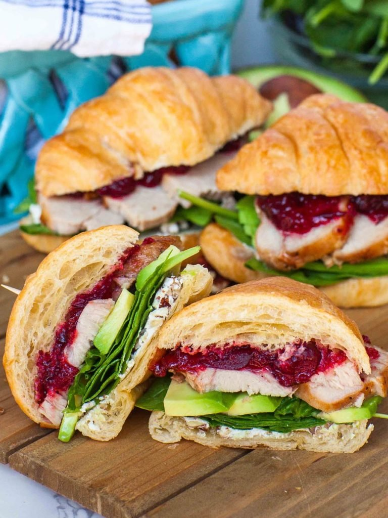 cranberry sandwich with cheese and avocado for thanksgiving turkey leftovers