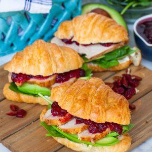 croissant sandwich with meat, cranberry
