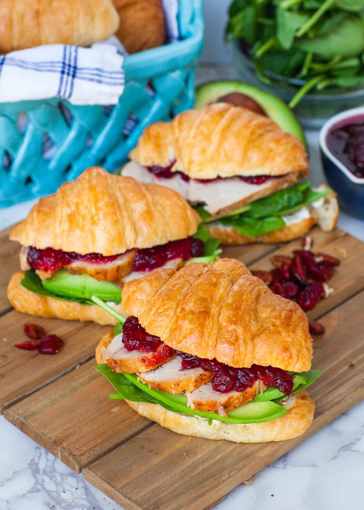 croissant sandwich with meat, cranberry