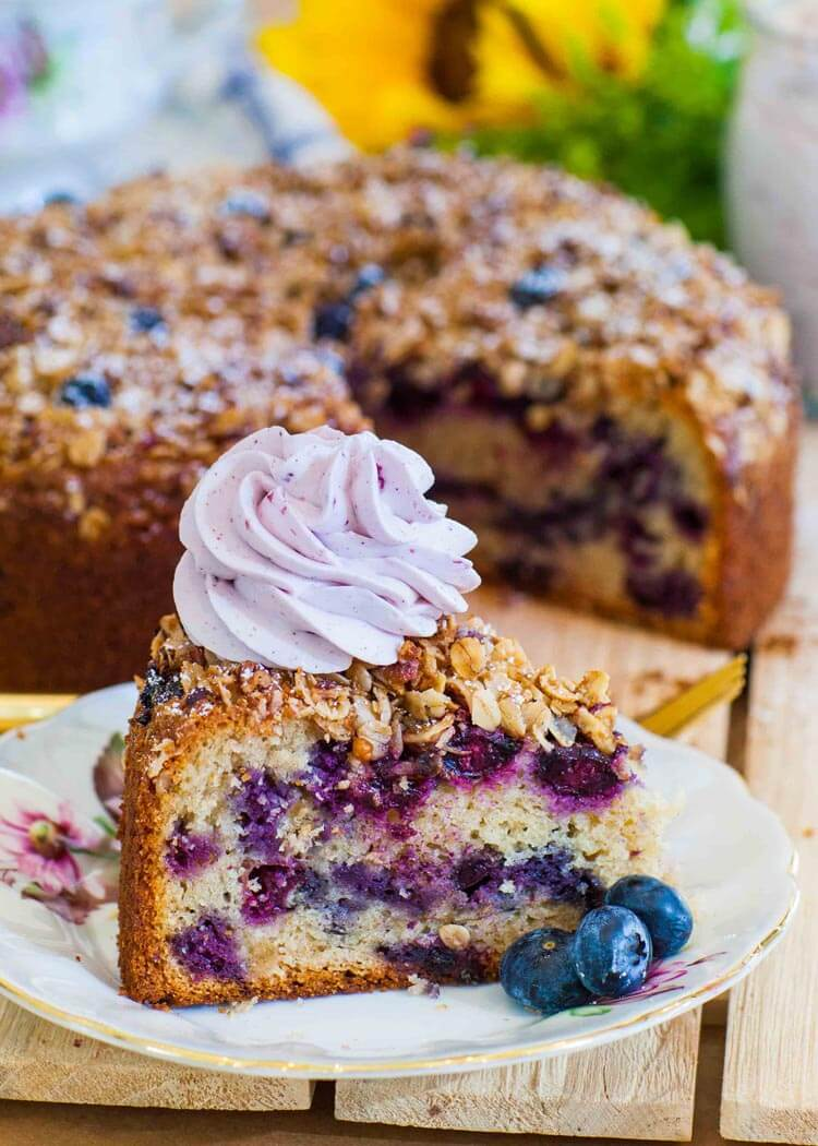blueberry cake slice with whipped cream