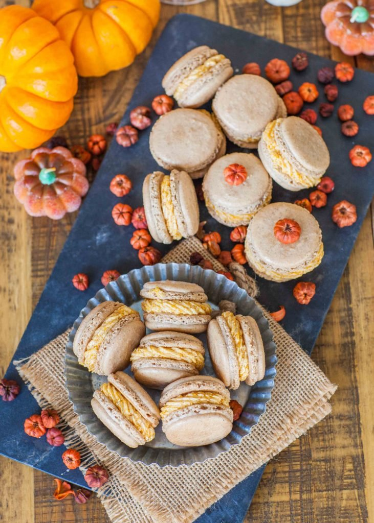 french macarons with pumpkin spice filling and caramel sauce