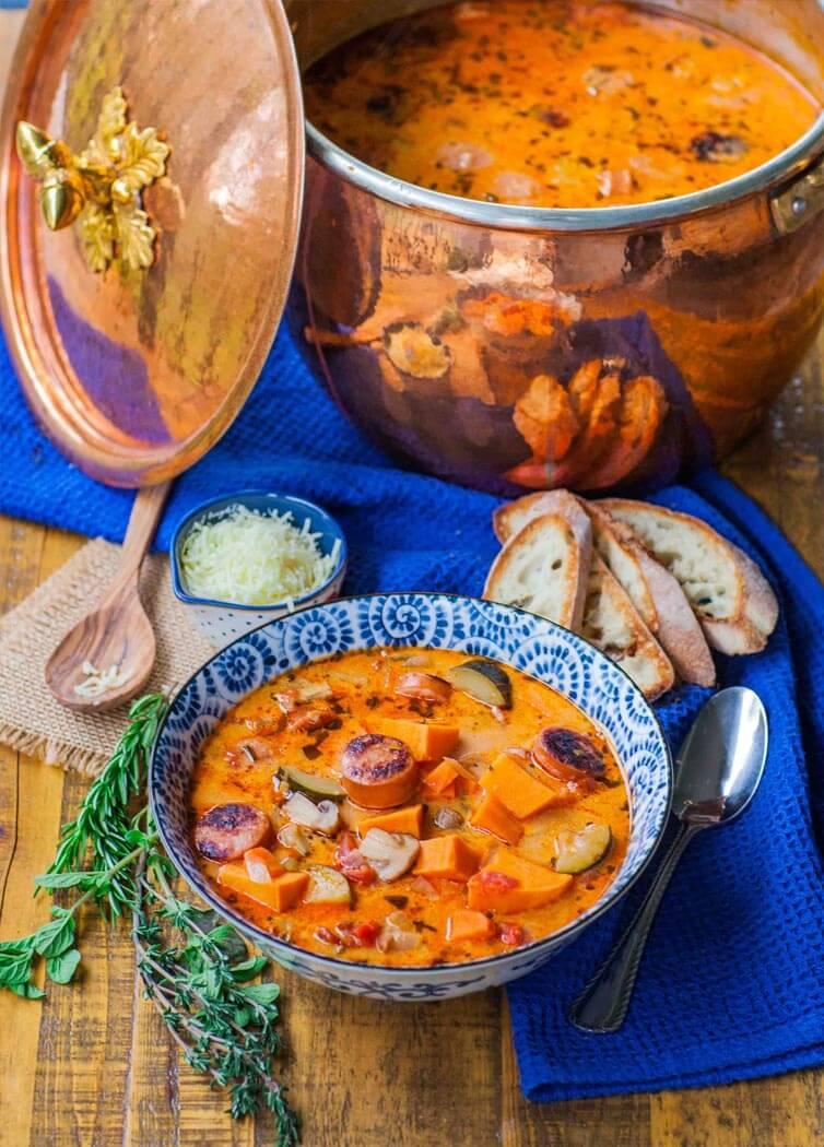 creamy sweet potato sausage soup in copper pot