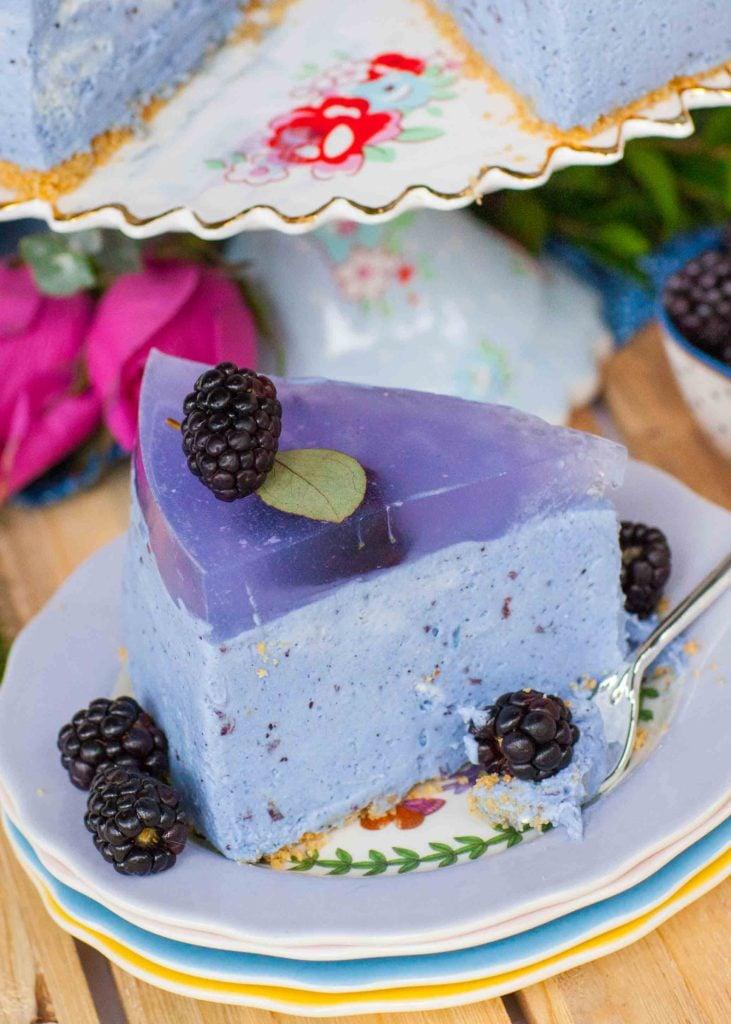 lavender mousse cake slice with blackberries