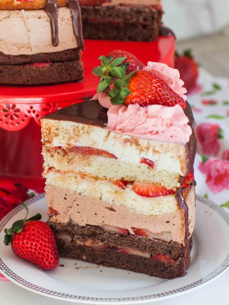 strawberry chocolate tuxedo cake recipe slice with fresh strawberries
