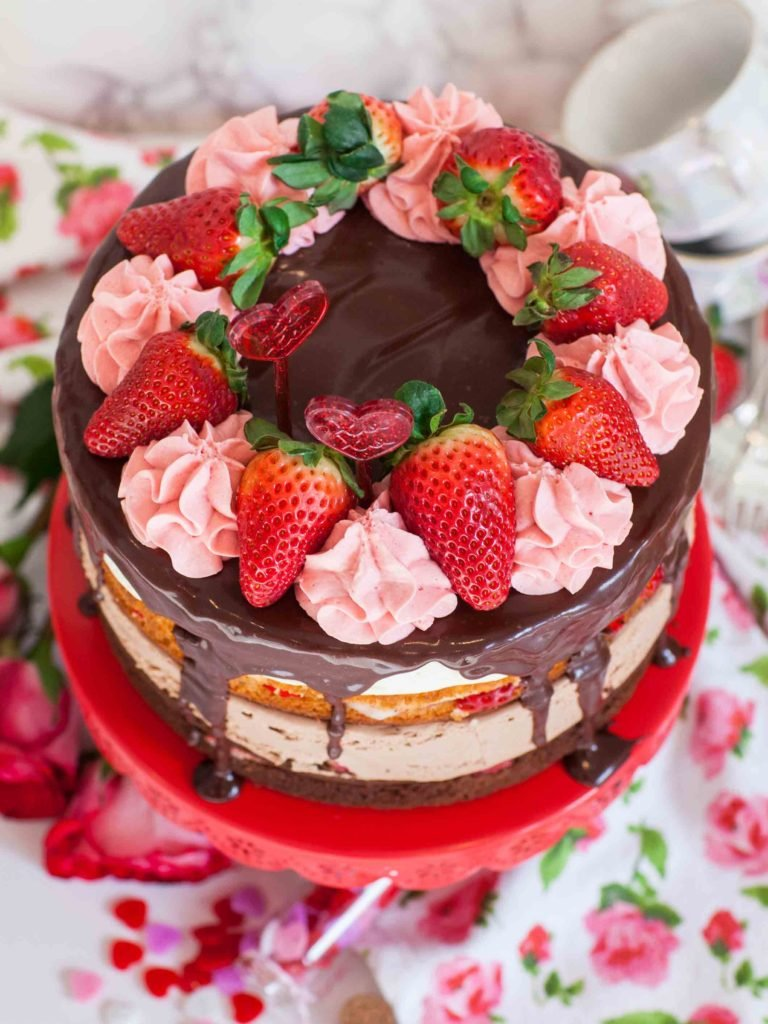 chocolate strawberry tuxedo cake with chocolate ganache