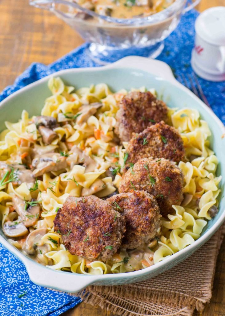 pasta dish with ground beef cutlets and mushroom gravy