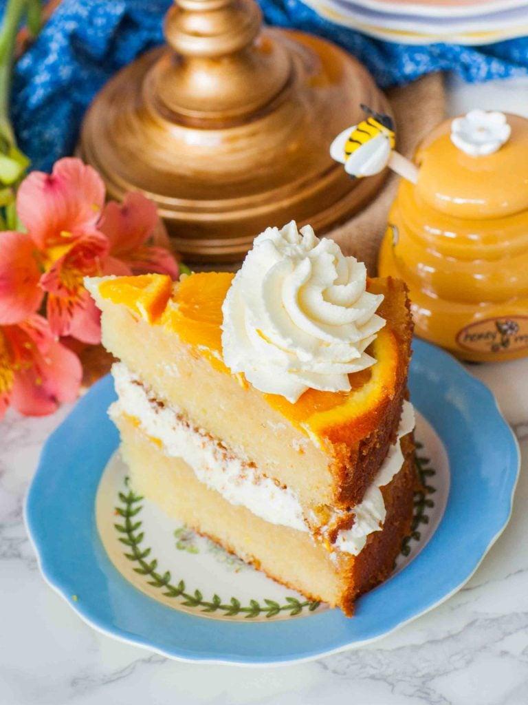 orange cake slice with whipped cream