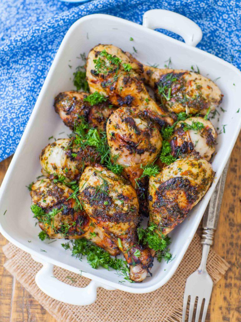 grilled chimichurri chicken drumsticks in casserole dish