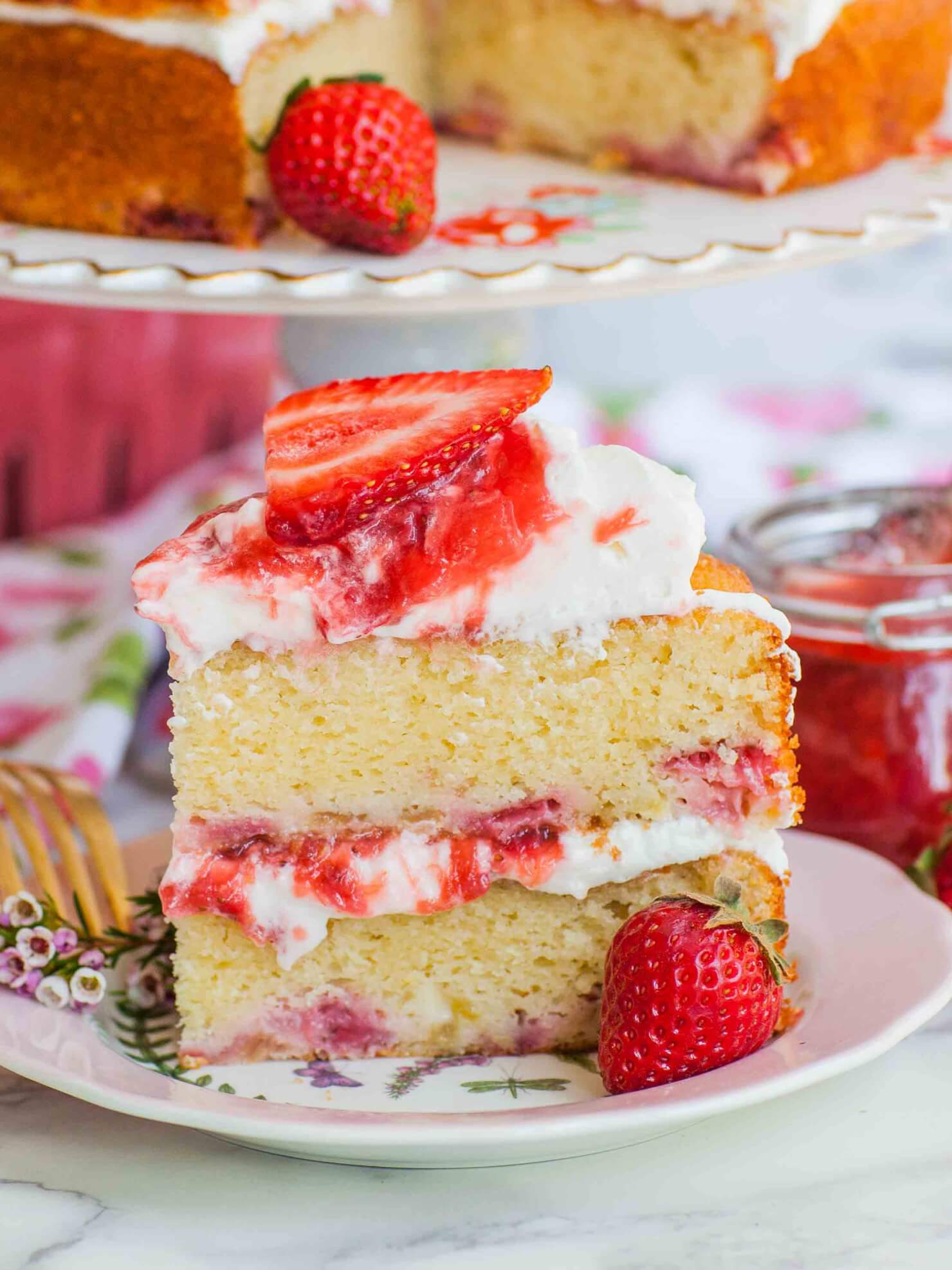 strawberry cake slice with whipped cream