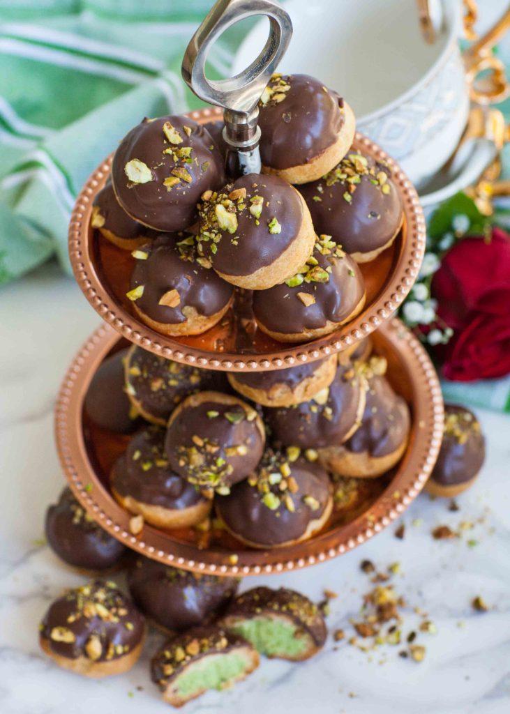 chocolate cream puffs with pistachio profiterole filling